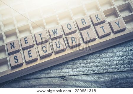 Closeup Of The Words Network Security Formed By Wooden Blocks In A Type Case
