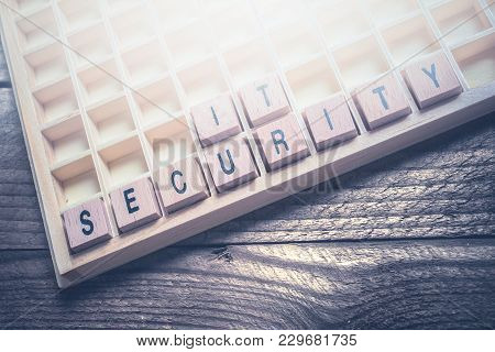 Closeup Of The Words It Security Formed By Wooden Blocks In A Typecase