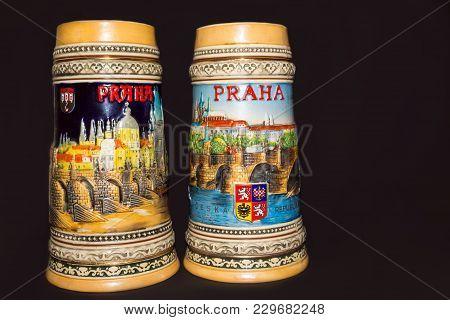 Prague, Czech Republic - February 25, 2018: Closeup Of Traditional Czech Beer Mugs On A Colored Back