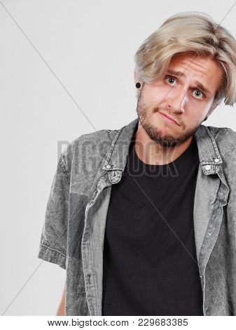 Confusion, Questionable. Standing Blonde Man Wearing Grey Shirt Being Confused, Studio Shot White Ba