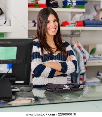 Portrait Of Happy Female Cashier At Cash Counter In Supermarket