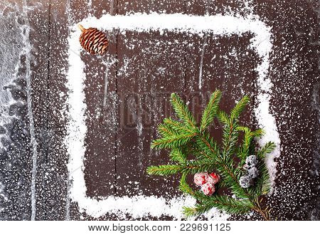 Frame Of The Snow With A Christmas Tree And A Bump On A Dark Wooden Background Snowy Winter Brochure