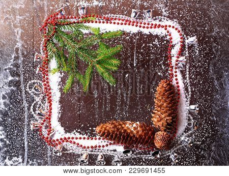 Frame Of The Snow With A Christmas Tree And Fir Cones On A Snowy Winter Dark Wooden Background Bookl