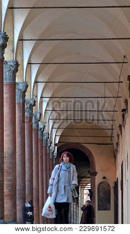 Bologna, Italy - January 29, 2018: People Walking Through A Portico, Sheltered Walkway