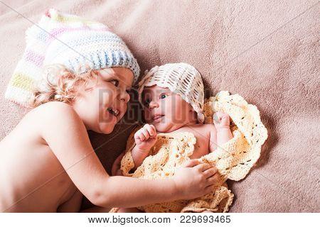 Little Girl Look For Her Newborn Sister, Siblings Portrait