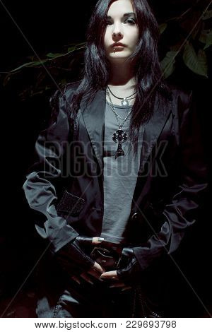 Asian Rock Star Posing In A Dark Forest