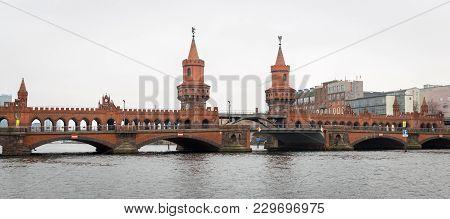 Oberbaum Bridge Over River Spree In Berlin City, Germany
