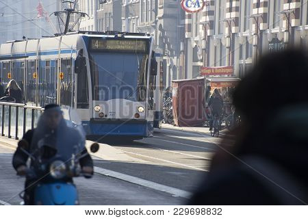 Amsterdam / The Netherlands - February 14th The City Tram Bringing Passengers To The Central Station