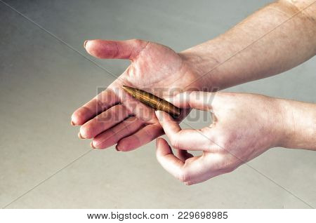 Conceptual Photography Against The War. A Big Bullet In The Hands Of A Girl.