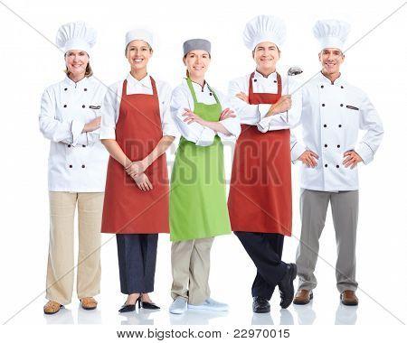 Grupo de cocineros sonrientes.  Aislado sobre fondo blanco. Gourmet.