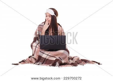 Image Of Young Girl With Sleeping Mask On Her Head. Ready To Sleep Girl With A Laptop. White Backgro