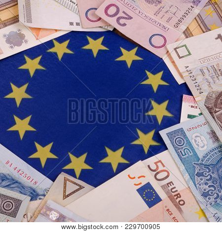Banknotes Polish Zlotys And Euros Are On The Heap. On The European Union Flag Background. Square. Cl