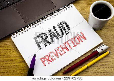 Writing Text Showing Fraud Prevention. Business Concept For Crime Protection Written On Notebook Boo