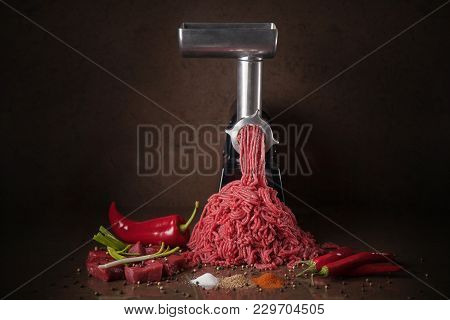 Juicy Meat Climbs Out Of The Meat Grinder. Minced Meat And Vegetables With Spices.