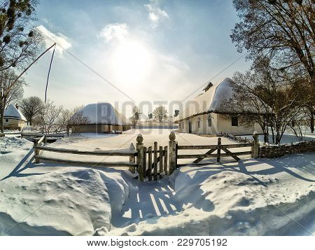 Snow-covered Village On A Winter Clear Day