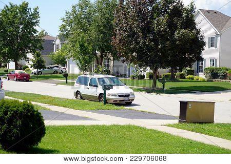 Joliet, Illinois / United States - July 30, 2017: An Old White Mercury Villager Estate Minivan Is Pa
