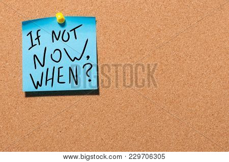 If Not Now, When Inspirational Message Pinned On Office Cork Board.