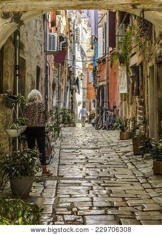 Rovinj, Croatia, September 27, 2017: Unknown Person Walking On A Old Cobbled Street In Rovinj.