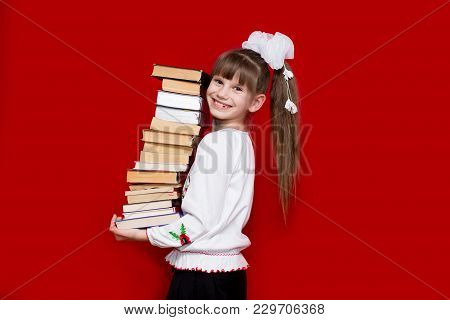 Portrait Of Cheerful Little Girl Isolated On Red Hold Many Literature. Concept Of Knowledge Or Schoo