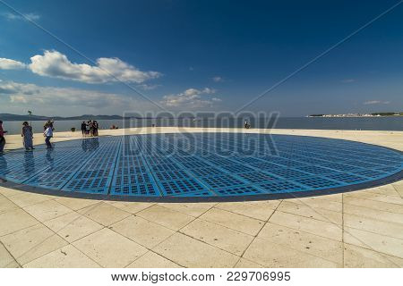 Trogir, Croatia, October 02, 2017: People Walk On 'the Greeting To The Sun', Tourist Attraction Made
