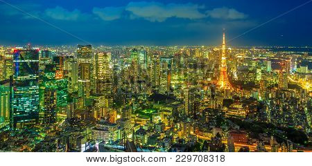 Panorama Of Tokyo Skyline At Blue Hour With Illuminated Tokyo Tower From Atop Observatory Of Mori To