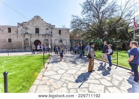 San Antonio, Texas - March 2, 2018 - People Get In Line To Visit The Historical Alamo Mission, Built
