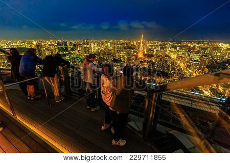 Tokyo, Japan - April 20, 2017: People Takes A Picture Of Tokyo Skyline And Tokyo Tower From Atop Of