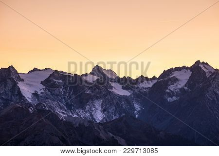 High Altitude Alpine Landscape At Dawn With First Light Glowing The Majestic High Peak Of The Barre