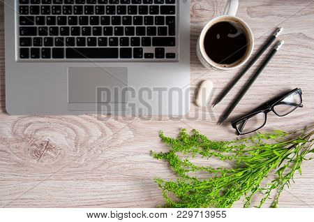 Notebook With Hot Coffee On Wood Table