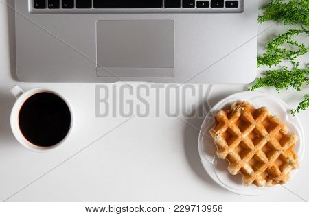 Notebook With Hot Coffee With Wafer On Wood Table