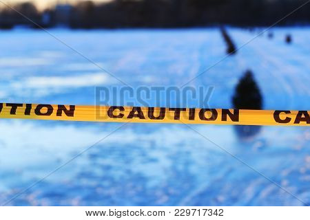Caution Or Warning Sign Of Drowning, Frozen Lake Formed By A Dam In The Winter Or At The Beginning O