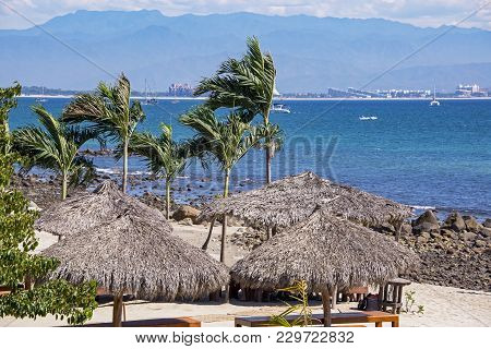 Pacific Ocean Background With Thatched Palm Palapas, Huanacaxtle, Jalisco, Mexico