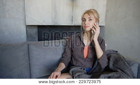 Merry Girl Chats With Close Friend On Phone And With Smile On Face Laughs Or Shares Latest News, Sit
