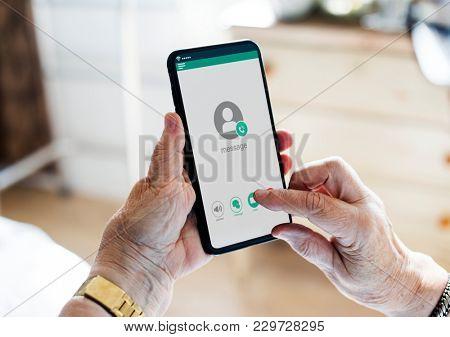 Closeup of hands using mobile phone