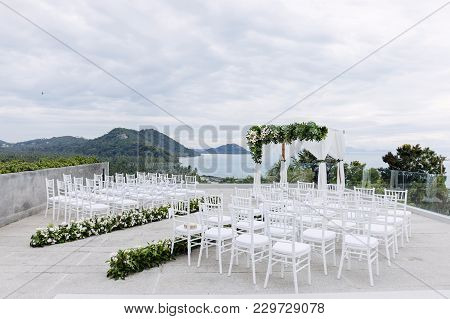 The Wedding Venue On The Hill With Panoramic Ocean View, The Arch, Altar Decorated With Flowers, Flo