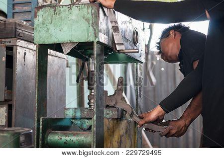 Close Up Machine Compress Bush Car Maintenance With Asian Mechanic Automotive