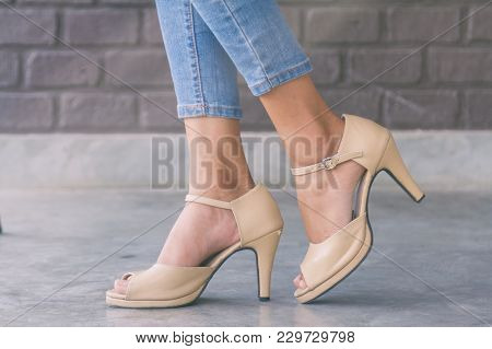 Close Up Of Woman Legs Wearing Fashion High Heel Shoes
