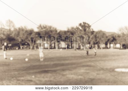 Blurred Image Group Of Indian Kids Playing Soccer At Local Park