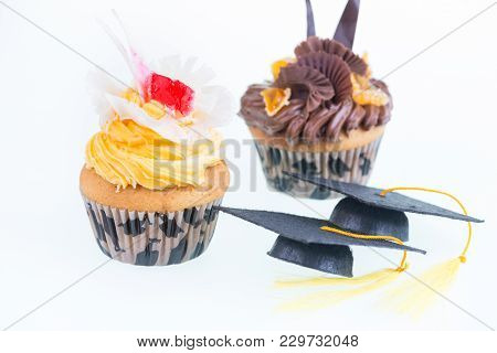 Graduation Cupcakes With Two Mortarboards Close Up