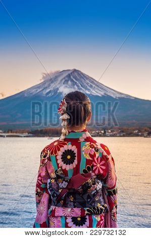 Asian Woman Wearing Japanese Traditional Kimono At Fuji Mountain. Sunset At Kawaguchiko Lake In Japa
