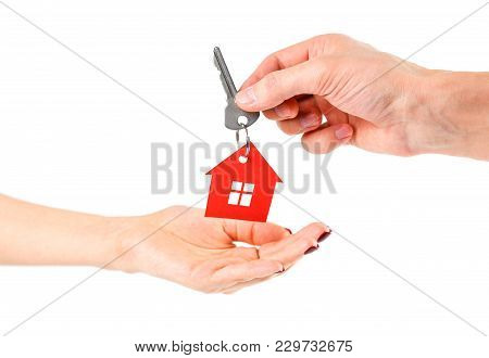 The Hand Holds The Keys With The Red House Keychain. Purchase Of Apartments. House In Hands. Close U