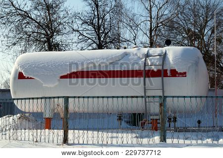 Fuel Tank Of Liquid Propane Gas Station. Fuel Tank Of Lpg Station Under Snow. Winter View Of  Lpg St