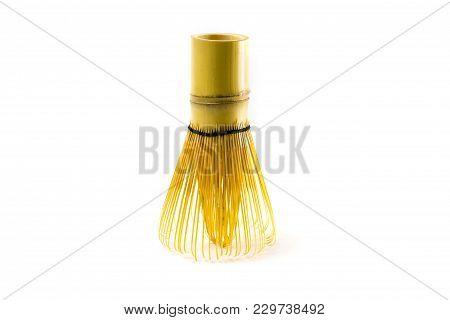 Honey In Jar And Wooden Honey Dipper Isolated On White Background With Clipping Path.