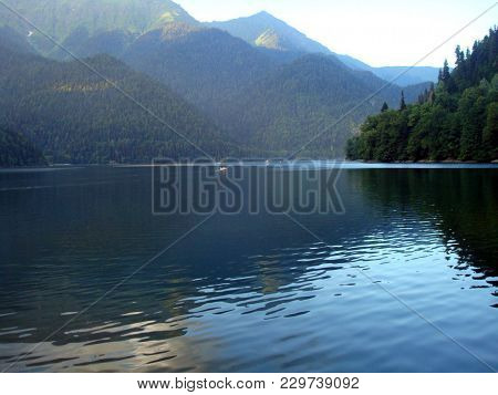 Panaromic View Of The Backwaters On A Background Of Mountains And Forests.