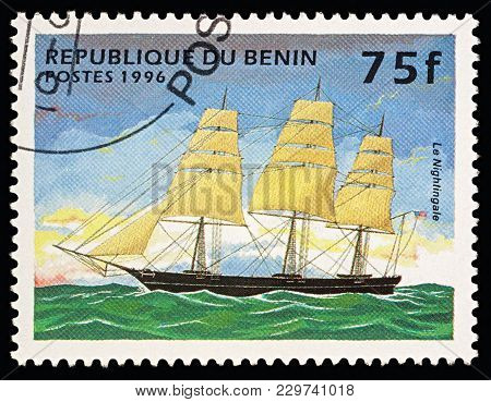 Moscow, Russia - March 06, 2018: A Stamp Printed In Benin Shows American Sailing Ship (clipper)