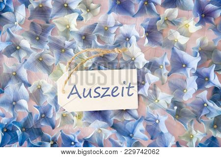 Label With German Text Auszeit Means Downtime. Sunny Flat Lay Of Hydrangea Blossoms.