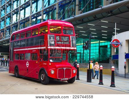LONDON - APRIL 17: Red Double Decker Bus on the Canon street in London on April 17, 2016 in London, UK. These dobledecker bus is one of the most iconic symbol of London.