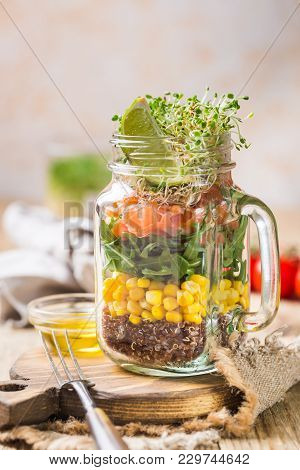 Fresh Spring Salad With Salmon, Quinoa, Arugula, Cress Salad And Corn In A Mason Jar For A Snack Wit