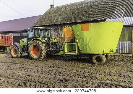 Agricultural Machinery And Equipment . The Tractor With Distributor Of Mixed Fodder For Cows . The Y