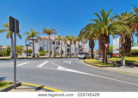 TENERIFE ISLAND, SPAIN - APRIL 10, 2017 : Street with typical Canary style holiday apartments in Costa Adeje, Tenerife, Canary Islands